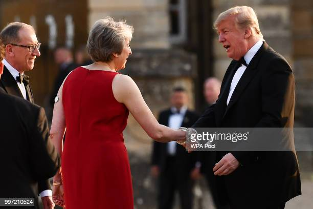 Britain's Prime Minister Theresa May greets US President Donald Trump at Blenheim Palace on July 12 2018 in Woodstock England Blenheim Palace is the...