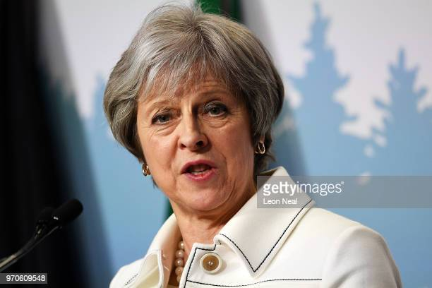 Britain's Prime Minister Theresa May holds a press conference at the end of the second day of the G7 Summit on June 9 2018 in La Malbaie Canada...