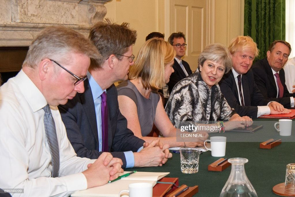 Britain's Prime Minister Theresa May holds the first Cabinet meeting of her new team, (L-R) Britain's Environment, Food and Rural Affairs Secretary Michael Gove, Britain's Business, Energy and Industrial Strategy Secretary Greg Clark, Britain's Education Secretary and Minister for Women and Equalities Justine Greening, Britain's Prime Minister Theresa May, Britain's Foreign Secretary Boris Johnson and Britain's International Trade Secretary Liam Fox at 10 Downing Street in London on June 12, 2017, following the June 8 snap general election in which the ruling Conservatives lost their majority. Prime Minister Theresa May is in a weakened position after losing her parliamentary majority in last week's election, leaving her vulnerable to both hardliners and moderates in her Conservative Party. / AFP PHOTO / POOL / Leon NEAL