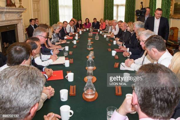 Britain's Prime Minister Theresa May holds the first Cabinet meeting of her new team at 10 Downing Street in London on June 12 following the June 8...