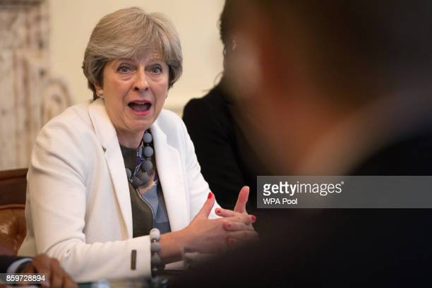 Britain's Prime Minister Theresa May hosts a discussion in the Cabinet Office following the publication of the Government's Race Disparity Audit at...