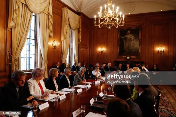 Britain's Prime Minister Theresa May hosts a Serious Youth Violence Summit flanked by London Mayor Sadiq Khan Youth Justice Board cochair Roy...