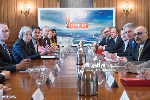 Britain's Prime Minister Theresa May hosts speaks as she hosts a round table meeting on technology inside 10 Downing Street in central London on June...