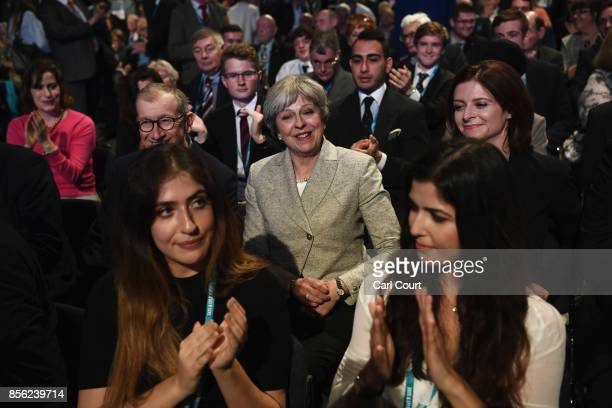Britain's Prime Minister Theresa May is applauded as she attends the first day of the annual Conservative Party conference on October 1 2017 in...