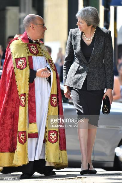 Britain's Prime Minister Theresa May is greeted by the Dean of Southwark Andrew Nunn on her arrival for a Service of Commemoration on the first...