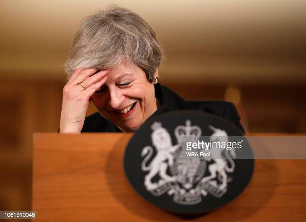 Britain's Prime Minister Theresa May laughs as she speaks during a press conference inside 10 Downing Street on November 15 2018 in London England...