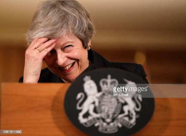 Britain's Prime Minister Theresa May laughs during a press conference inside 10 Downing Street on November 15 2018 in London England Cabinet...