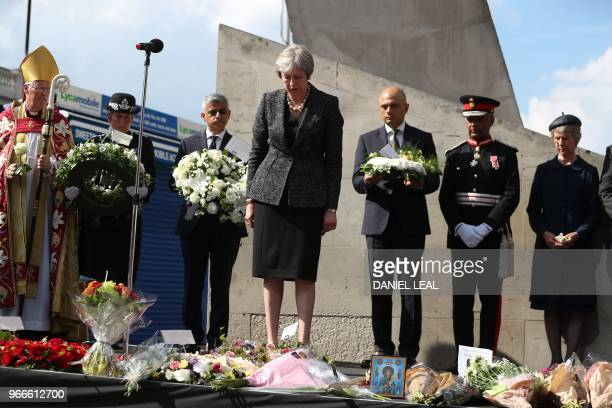 Britain's Prime Minister Theresa May lays a floral tribute at Southwark Needle on London Bridge London on June 3 during a commemoration service on...