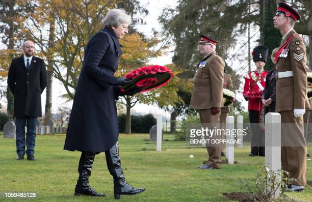 Britain's Prime Minister Theresa May lays a wreath during the commemoration of the 100th anniversary of the end of the First World War at the...