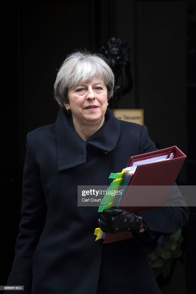 Britain's Prime Minister Theresa May leaves 10, Downing Street for Prime Minister's Questions on December 6, 2017 in London, England. Mrs May spoke to DUP leader Arlene Foster this morning as negotiations continue over the Irish border issue.