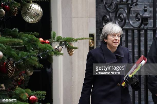 Britain's Prime Minister Theresa May leaves 10 Downing Street for Prime Minister's Questions on December 6 2017 in London England Mrs May spoke to...