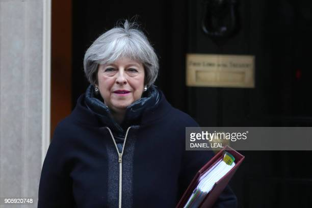 Britain's Prime Minister Theresa May leaves 10 Downing street for the weekly Prime Minister Question session in the House of Commons in London on...