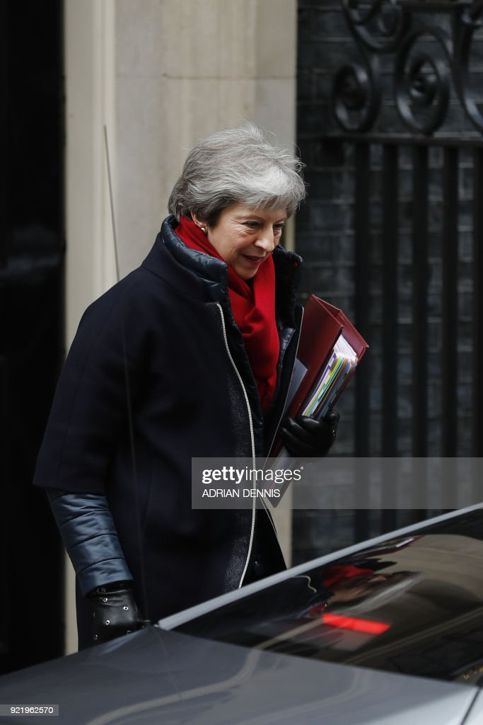 Britain's Prime Minister Theresa May leaves 10 Downing street for the weekly Prime Minister Question (PMQ) session in the House of Commons in London on February 21, 2018. / AFP PHOTO / Adrian DENNIS