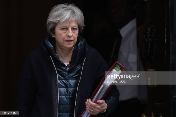 TOPSHOT Britain's Prime Minister Theresa May leaves 10 Downing street for the weekly Prime Minister Question session in the House of Commons in...