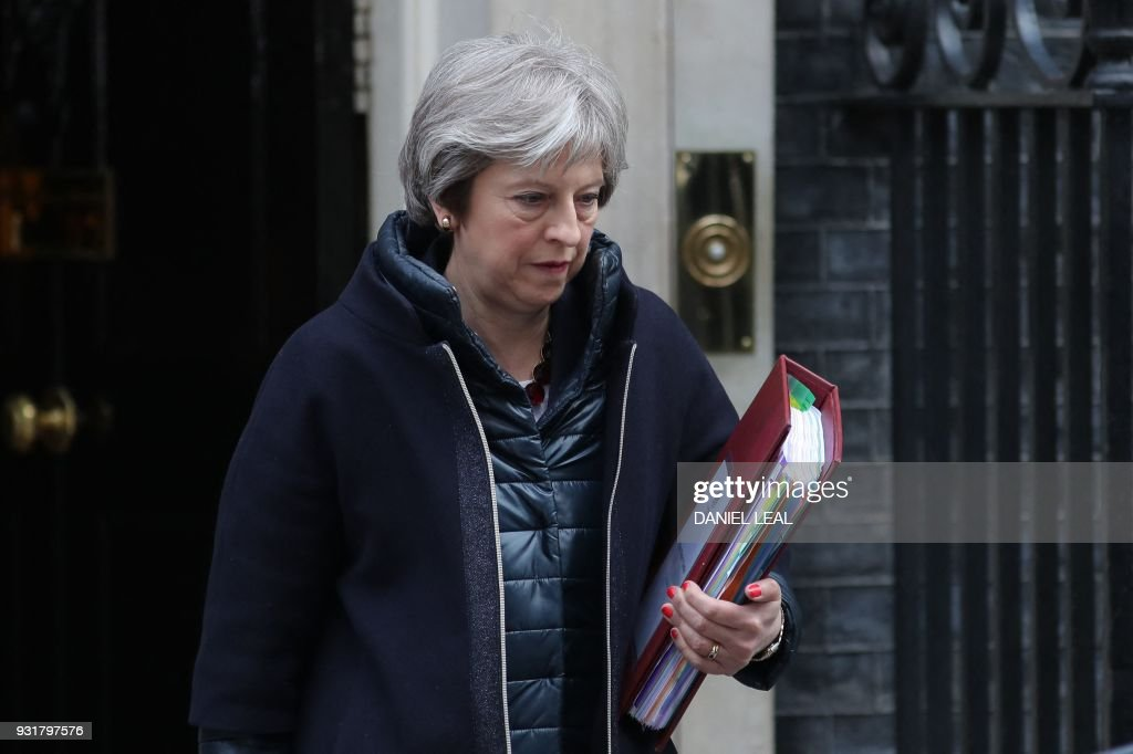 Britain's Prime Minister Theresa May leaves 10 Downing street for the weekly Prime Minister Question (PMQ) session in the House of Commons in London on March 14, 2018. / AFP PHOTO / Daniel LEAL