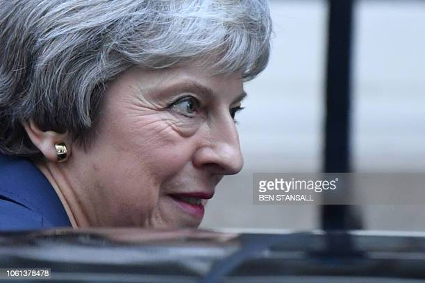 Britain's Prime Minister Theresa May leaves 10 Downing Street in London on November 14 to attend the weekly Prime Minister's Questions at the Houses...