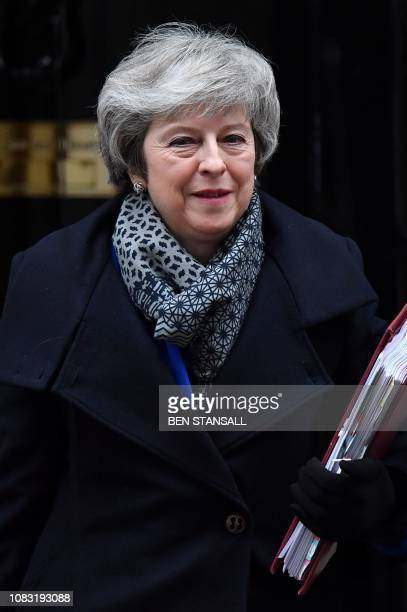 Britain's Prime Minister Theresa May leaves 10 Downing Street in London on January 16, 2019 ahead of Prime Minister's Questions to be followed by a...