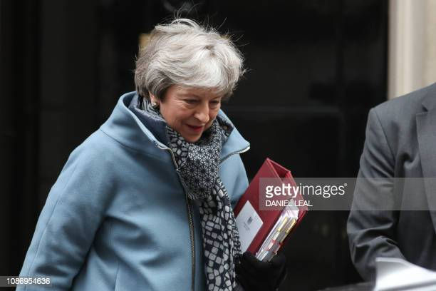Britain's Prime Minister Theresa May leaves 10 Downing Street in London on January 23 2019 ahead of Prime Minister's Questions British MPs frustrated...
