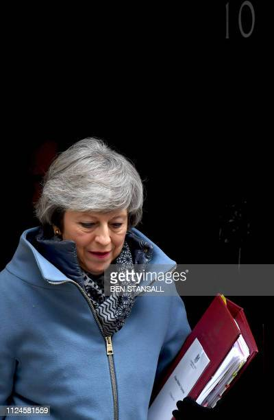 Britain's Prime Minister Theresa May leaves 10 Downing Street in London on February 13 2019 ahead of the weekly Prime Ministers Questions session in...
