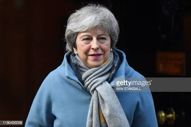 Britain's Prime Minister Theresa May leaves 10 Downing Street in London on March 14 ahead of a further Brexit vote British MPs will vote today on...