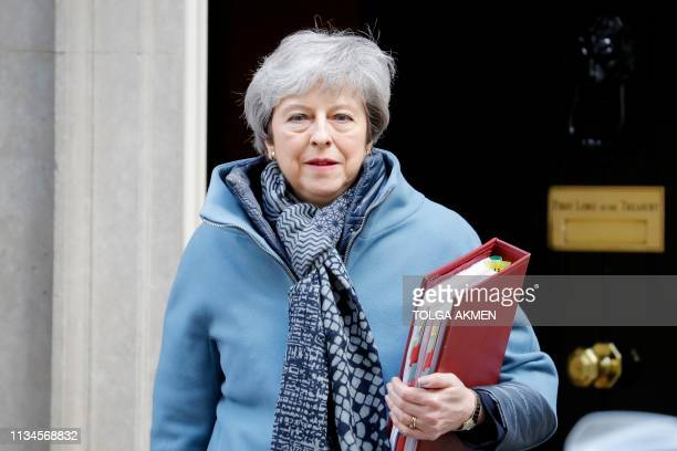 Britain's Prime Minister Theresa May leaves 10 Downing Street in London on April 3, 2019 ahead of the weekly Prime Minister's Questions question and...