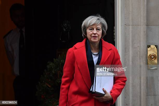 Britain's Prime Minister Theresa May leaves 10 Downing Street in London on December 20 2016 ahead of an evidence session with the Commons Liason...