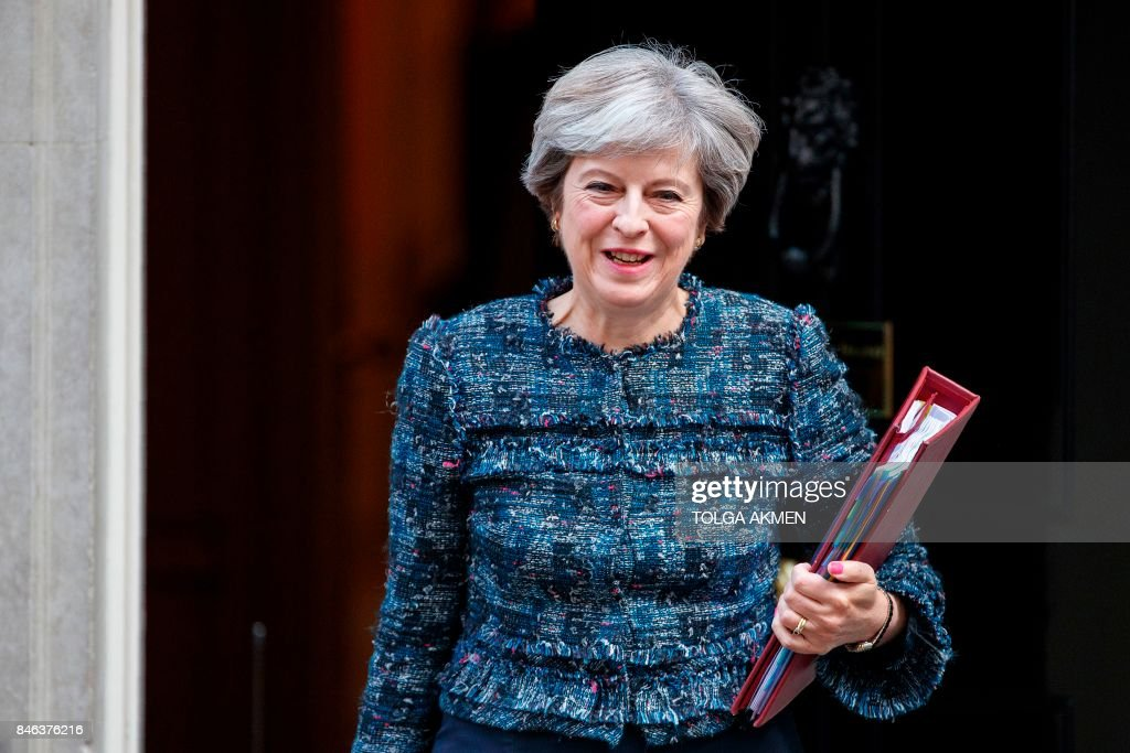 Britain's Prime Minister Theresa May leaves 10 Downing Street in central London on September 13, 2017, on her way to the Houses of Parliament to speak at Prime Minister's Questions (PMQs). After navigating the first hurdle of a key Brexit bill, British Prime Minister Theresa May on Tuesday won another parliamentary vote which will help prevent opposition MPs from blocking future legislation. / AFP PHOTO / Tolga AKMEN