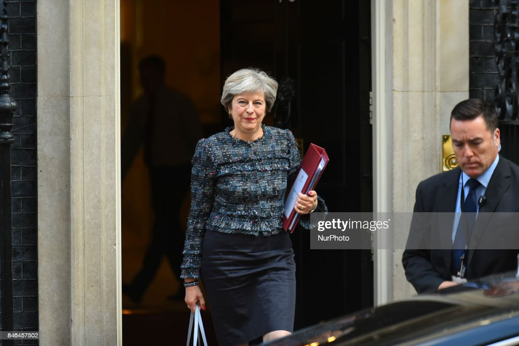 Britain's Prime Minister Theresa May leaves 10 Downing Street in central London on September 13, 2017, on her way to the Houses of Parliament to speak at Prime Minister's Questions (PMQs). After navigating the first hurdle of a key Brexit bill, British Prime Minister Theresa May on Tuesday won another parliamentary vote which will help prevent opposition MPs from blocking future legislation.