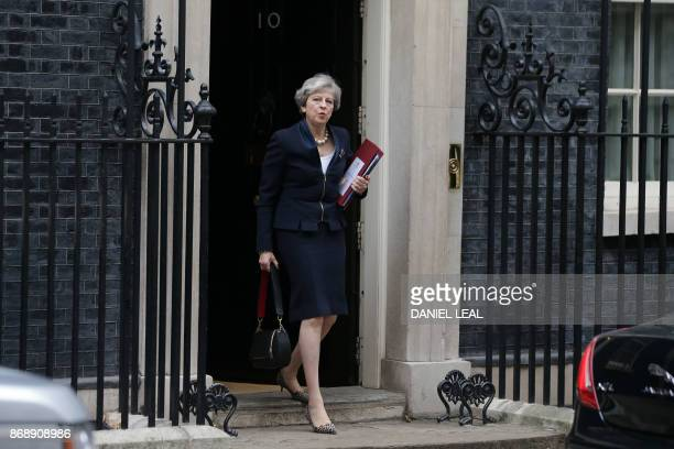 Britain's Prime Minister Theresa May leaves 10 Downing Street in central London on November 1 2017 ahead of the weekly Prime Minister's Questions...