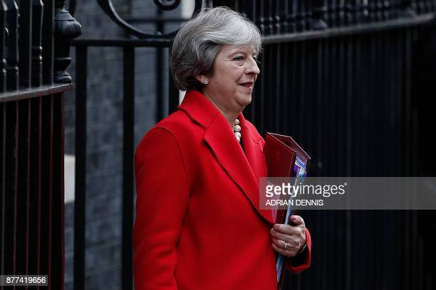 Britain's Prime Minister Theresa May leaves 10 Downing Street in central London on November 22 before heading to the House of Commons to attend the...