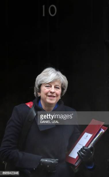 Britain's Prime Minister Theresa May leaves 10 Downing Street in central London on December 20 2017 ahead of the weekly Prime Minister's Questions...