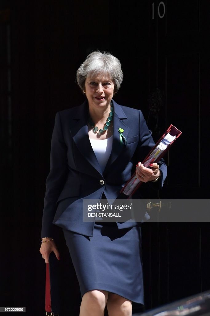 Britain's Prime Minister Theresa May leaves 10 Downing Street in central London on June 13, 2018, as she heads to the weekly Prime Minister's Questions (PMQs) session in the House of Commons.