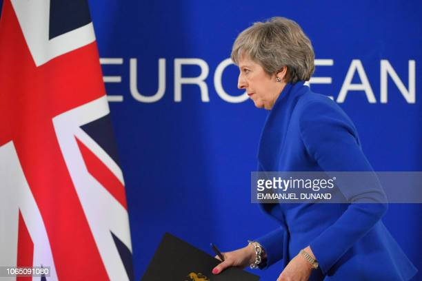 Britain's Prime Minister Theresa May leaves after a press conference following a special meeting of the European Council to endorse the draft Brexit...