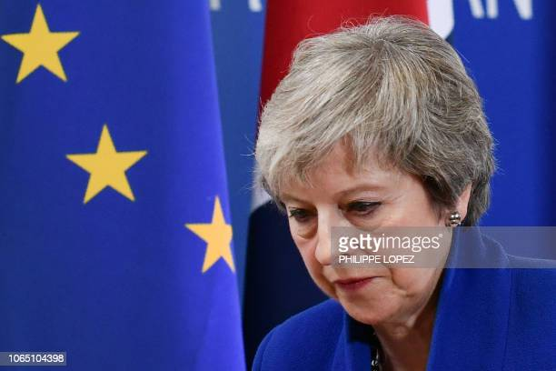TOPSHOT Britain's Prime Minister Theresa May leaves after a press conference following a special meeting of the European Council to endorse the draft...