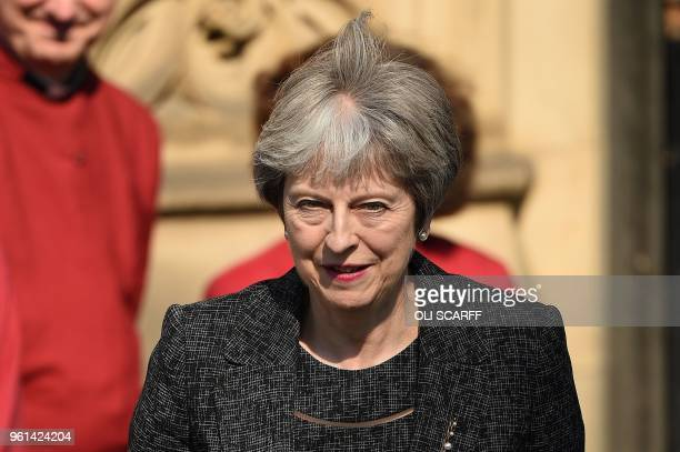 Britain's Prime Minister Theresa May leaves after attending The Manchester Arena National Service of Commemoration at Manchester Cathedral in central...