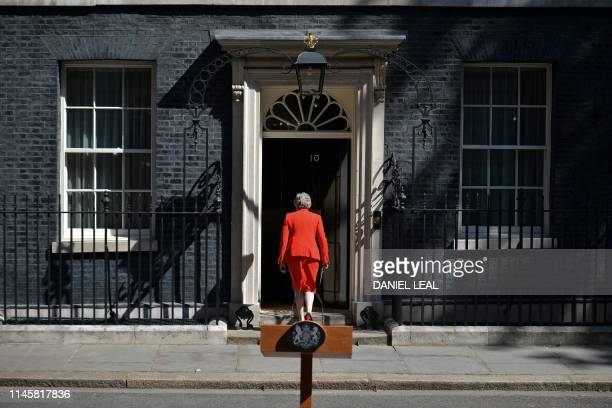 Britain's Prime Minister Theresa May leaves after she announces her resignation outside 10 Downing street in central London on May 24, 2019. -...