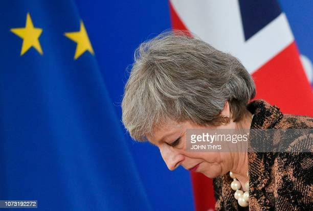 Britain's Prime Minister Theresa May leaves after speaking during a press conference on December 14 2018 in Brussels on the second day of a European...