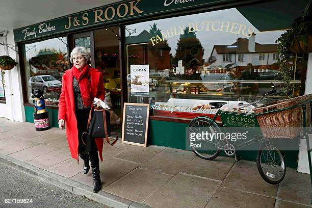 Britain's Prime Minister Theresa May leaves after visiting a local butchers shop in her constituency of Maidenhead ahead of Small Business Saturday...