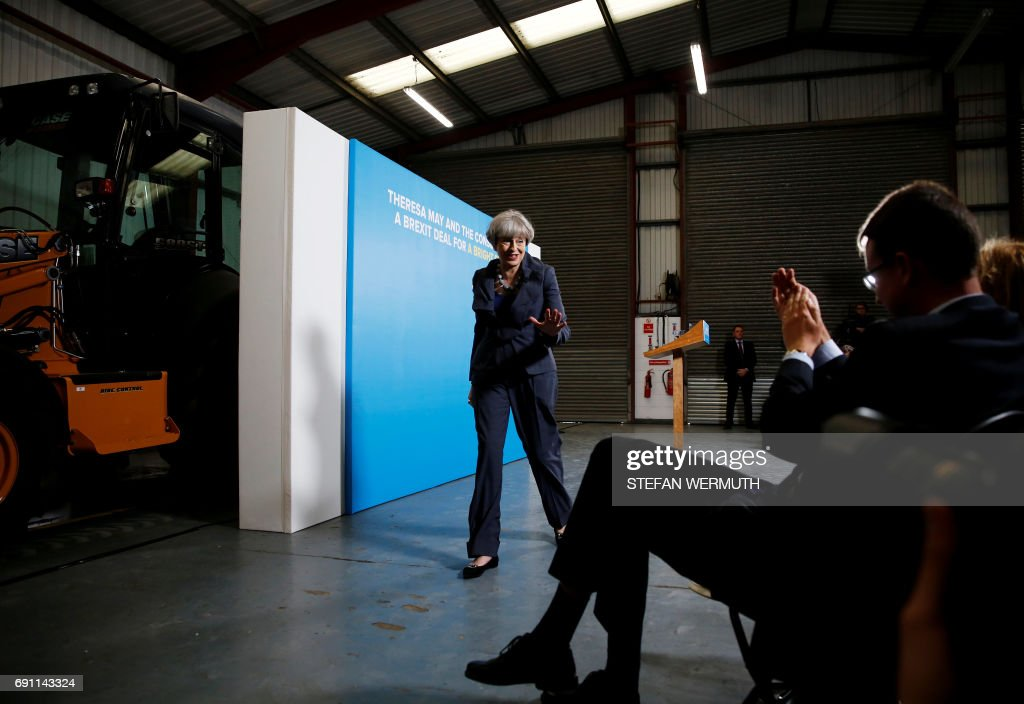 Britain's Prime Minister Theresa May leaves an election campaign event in Guisborough, southeast of Middlesbrough, in northeast England, on June 1, 2017. /