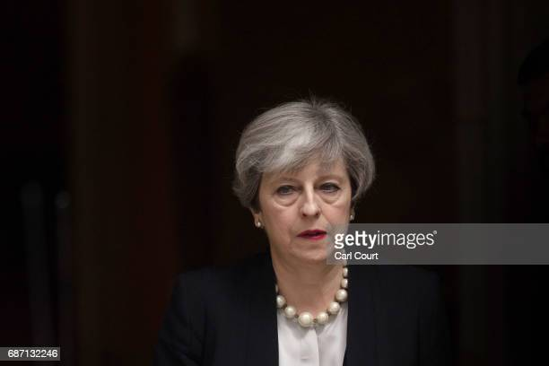 Britain's Prime Minister Theresa May leaves Downing Street after addressing the media following a COBRA meeting to discuss the government's response...