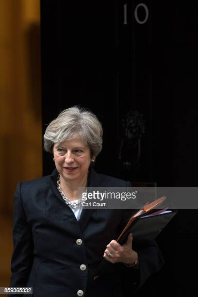 Britain's Prime Minister Theresa May leaves Downing Street to deliver a statement on Brexit to the House of Commons on October 9 2017 in London...