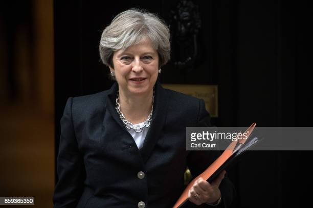 Britain's Prime Minister, Theresa May, leaves Downing Street to deliver a statement on Brexit to the House of Commons on October 9, 2017 in London,...