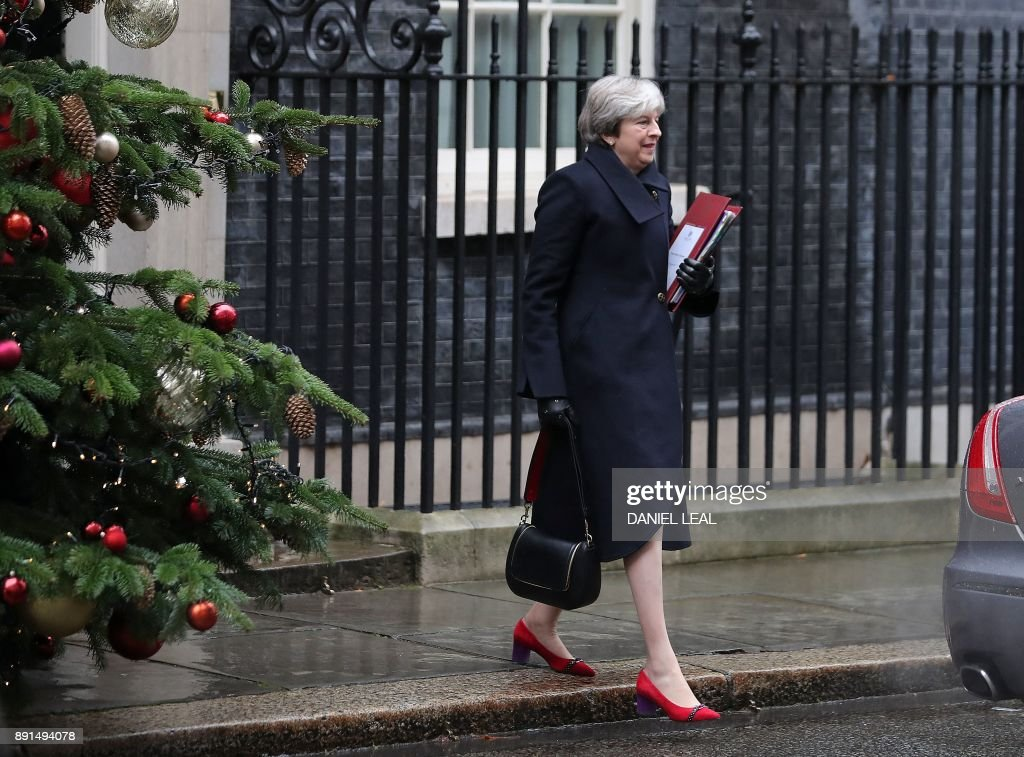 Britain's Prime Minister Theresa May leaves for the weekly Prime Minister Question (PMQ) session in the House of Commons, from Downing Street in central London on December 13, 2017. / AFP PHOTO / Daniel LEAL