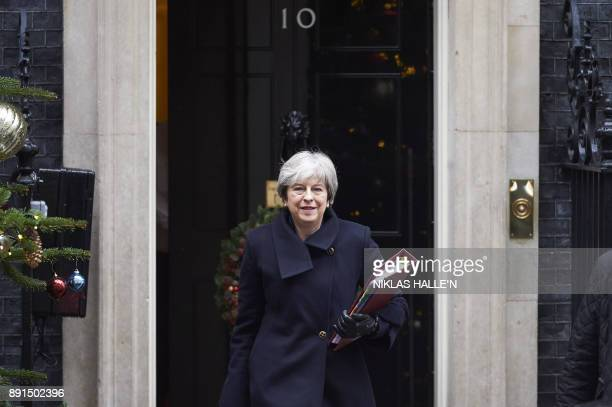 Britain's Prime Minister Theresa May leaves for the weekly Prime Minister Question session in the House of Commons from Downing Street in central...