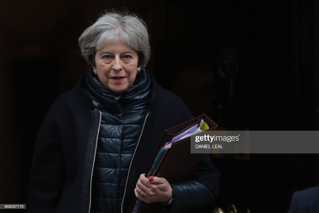 Britain's Prime Minister Theresa May leaves for the weekly Prime Minister Question (PMQ) session in the House of Commons, from Downing Street in central London on January 10, 2018. / AFP PHOTO / Daniel LEAL