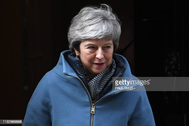 Britain's Prime Minister Theresa May leaves from 10 Downing Street on March 26 2019 Britain's parliament began plotting a new Brexit strategy today...