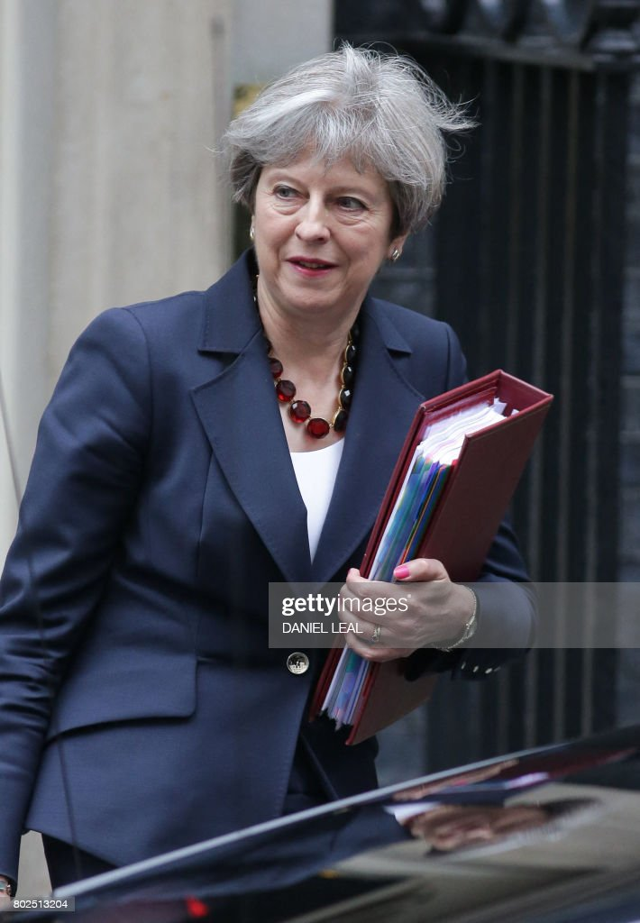 Britain's Prime Minister Theresa May leaves No 10 Downing St on her way to Westminster for Prime Minister's Question Time (PMQs), in central London on June 28, 2017. / AFP PHOTO / Daniel LEAL