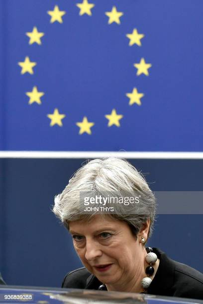 Britain's Prime minister Theresa May leaves on the second day of a summit of European Union leaders at the European Council headquarter in Brussels...