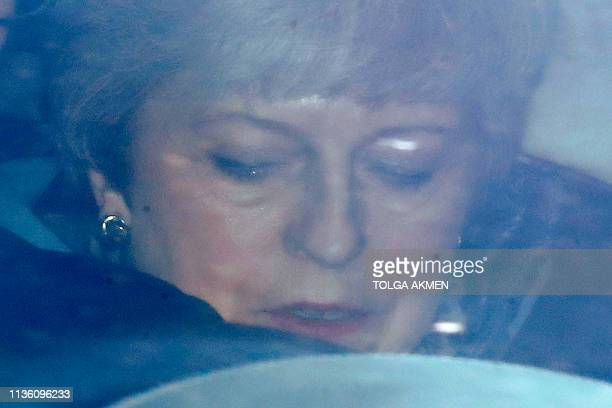 Britain's Prime Minister Theresa May leaves the Houses of Parliament in London on April 10 following the weekly Prime Minister's Questions question...