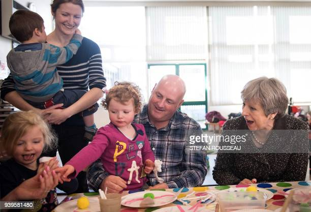 Britain's Prime Minister Theresa May meets a attendees at a local parent and toddler group at Heddon-On-the-Wall, St Andrew's Church of England...